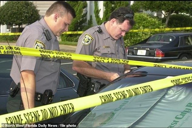 Police officers investigate the scene of Rep. Joe Scarborough'sFort Walton Beach office after employee Lori Klausutis was found dead in July 2001. Authorities found that Scarborough was in D.C. at the time and Klausutis had an undiagnosed heart condition
