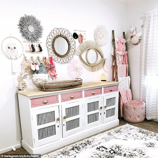 Her daughter's room is a pop of pink, with a Kmart ladder used to hang up her rugs, blankets and scarves in the corner (pictured)