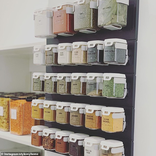 The 'interior lover' from Melbourne purchased the MoBin Starter Bundle Of 28 Spice Containers from TM Essentials for $219.95, mounting them on a rail that comes with the pack inside her pantry