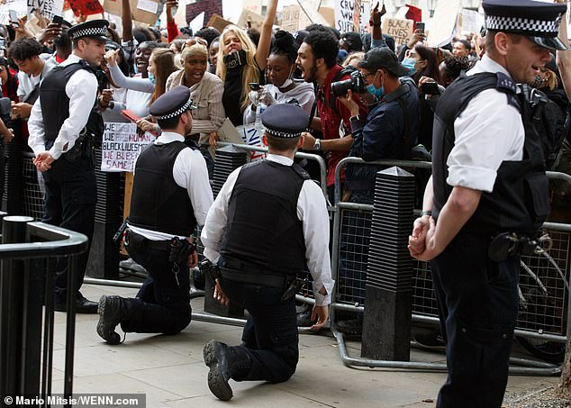 Metropolitan Police officers take a knee at yesterday's Black Lives Matter protest in London