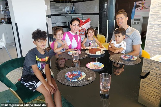 Family: The sportsman also shared a snapshot with his family while tasting the twins' birthday cake
