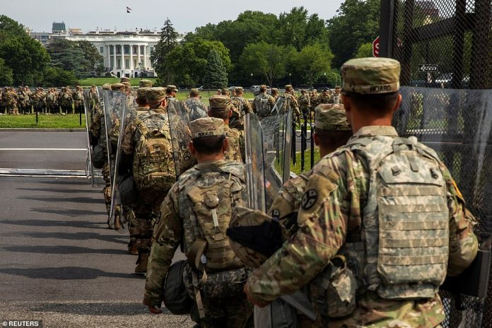 WASHINGTON, D.C .: Troops surrounded a barricaded white house on Saturday as Washington DC prepared for the biggest demonstration by George Floyd to date. Protesters remain fenced from the streets to the White House by a fence