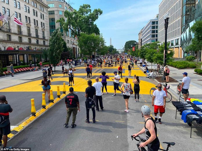 WASHINGTON, D.C .: Protesters began to assemble early Saturday morning as dozens of demonstrations are scheduled. In the photo, here is the stretch of road in front of the White House which was painted with Black Lives Matter