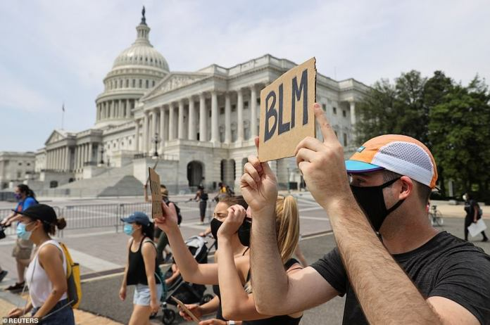 WASHINGTON, D.C .: Protesters walk past the United States Capitol on Saturday morning. Other protests will take place in front of the office buildings of the United States Senate, the Wilson Building of the D.C. government, in Judiciary Square, Freedom Plaza