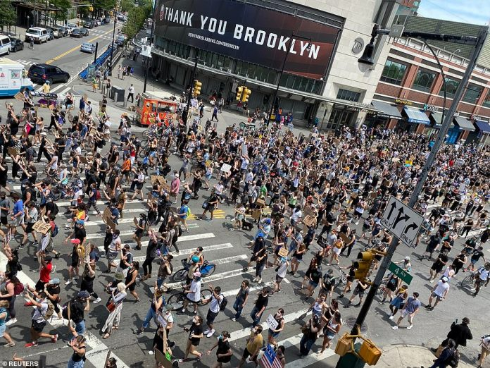 BROOKLYN, NEW YORK CITY: Protesters walk down Brooklyn's Flatbush Avenue towards the Manhattan Bridge chanting slogans as thousands of people again joined citywide protests on Saturday for the 12th consecutive day