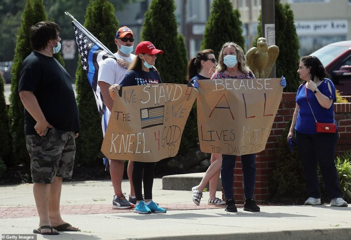 BETHPAGE, NEW YORK: A group of counter-protesters lined Stewart Avenue one block from Black Lives Matter protesters in Bethpage. They wore All Lives Matter signs and wore MAGA hats
