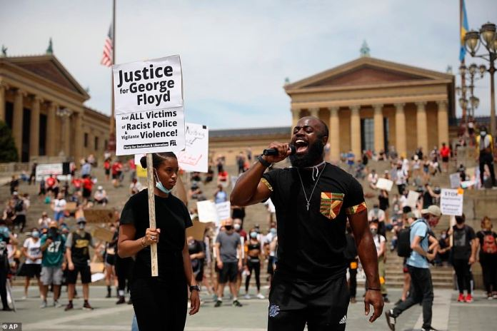 PHILADELPHIA: Wallace Weaver, of Mount Airy, Philadelphia, speaks on the microphone to encourage protesters who demonstrate to register to vote at the Philadelphia Art Museum as a protest began to march on City Hall on Saturday