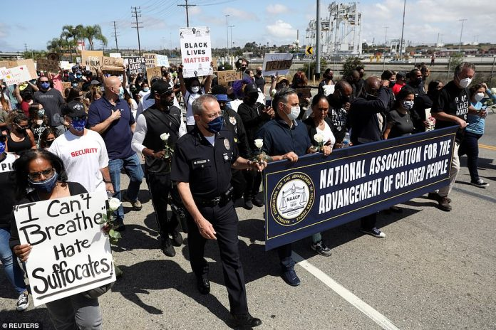 LOS ANGELES, CALIFORNIA: LAPD chief Michel Moore, Los Angeles council member Joe Buscaino and NAACP San Pedro / Wilmington chapter president Dr. Cheyenne Bryant attend = walk =