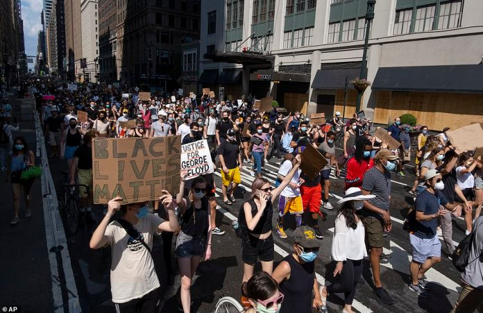 MANHATTAN, NEW YORK CITY: Activists move along 7th Avenue as they walked for miles during a peaceful protest