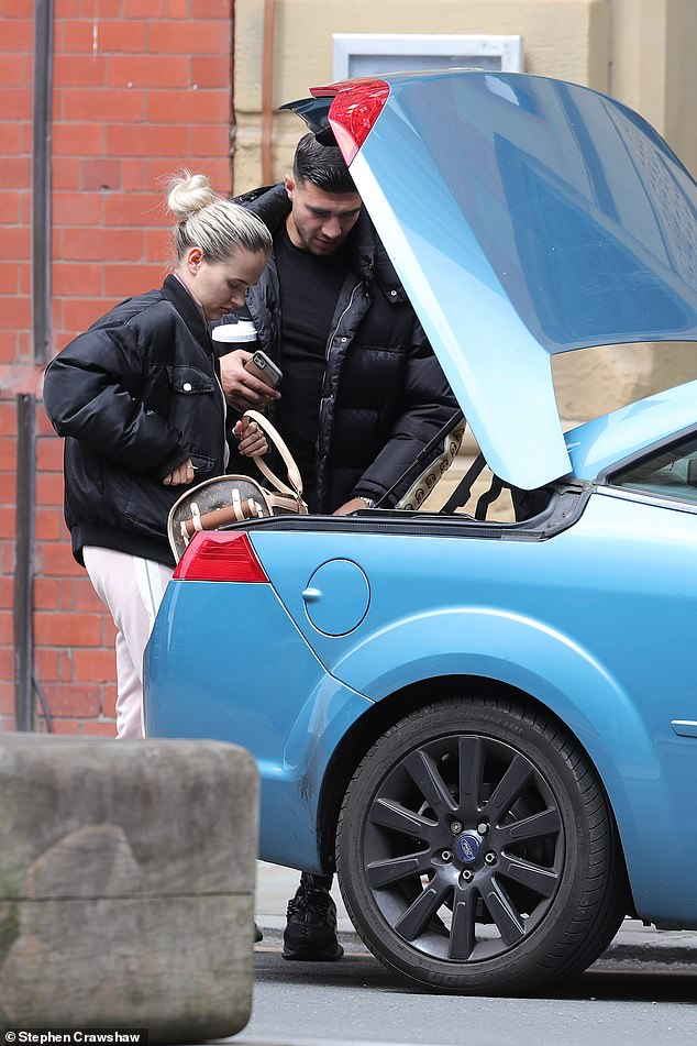 Souvenirs: The Love Island stars, both 21, looked gloomy by unloading the Louis Vuitton dog carrier for £ 2,000 they used for the cabot of their car