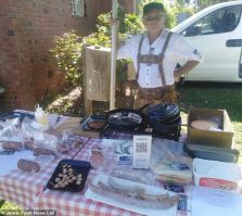 Eduard, above, stands with his German sausage stall at an outdoor market in South Africa. He had opened his German-themed restaurant and B&B business in 2010 with partner Margit