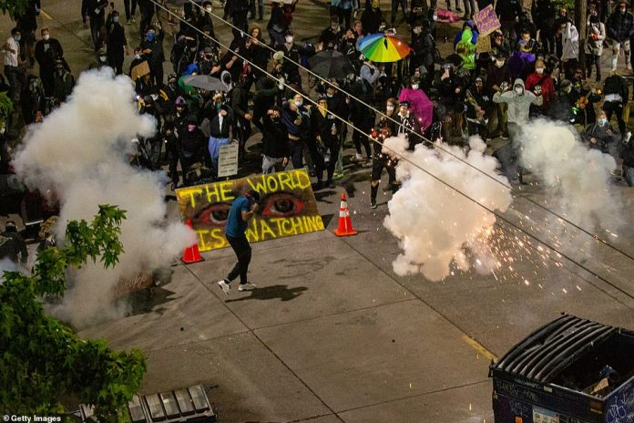 Protests became violent Sunday evening when a man plowed his car in the crowd and shot a 27-year-old protester