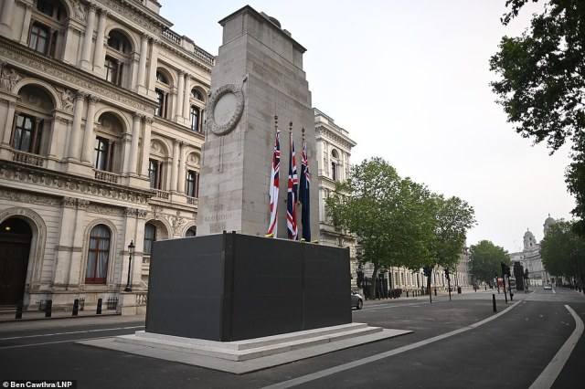 Dawn breaks at the Cenotaph, Britain's memorial to its glorious war dead, was boarded up on Thursday evening in anticipating of further Black Lives Matter marches this weekend