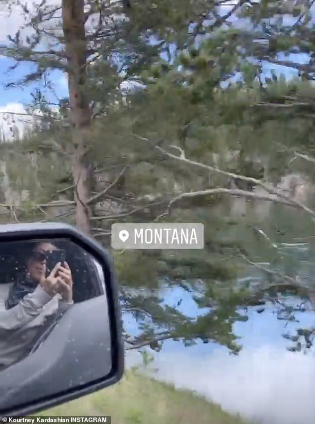 Getting away from it all: Kourtney filmed the stunning scenery on a car ride by a lake in Montana