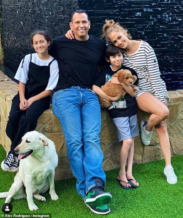 Sweet: They recently surprised her son Max, 12, with a Goldendoodle puppy, sharing a new family snap on Instagram
