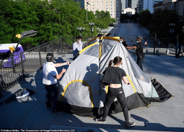Demonstrators begin to set up a tent in Legislative Plaza in Nashville as they attempt to establish their own 'autonomous zone' on Friday, following the inspiration of demonstrators in Seattle