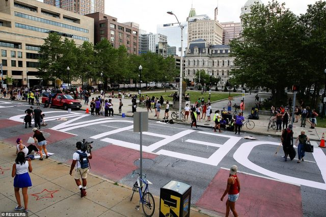 "BALTIMORE: ""Defund police"" is painted in front of Baltimore City Hall as demonstrators take part in a protest"