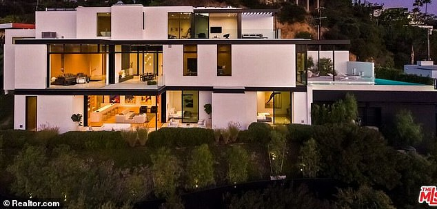 Big spender: Grande also dropped down $13.7 million for 10,000-square-foot contemporary Hollywood Hills home earlier this month
