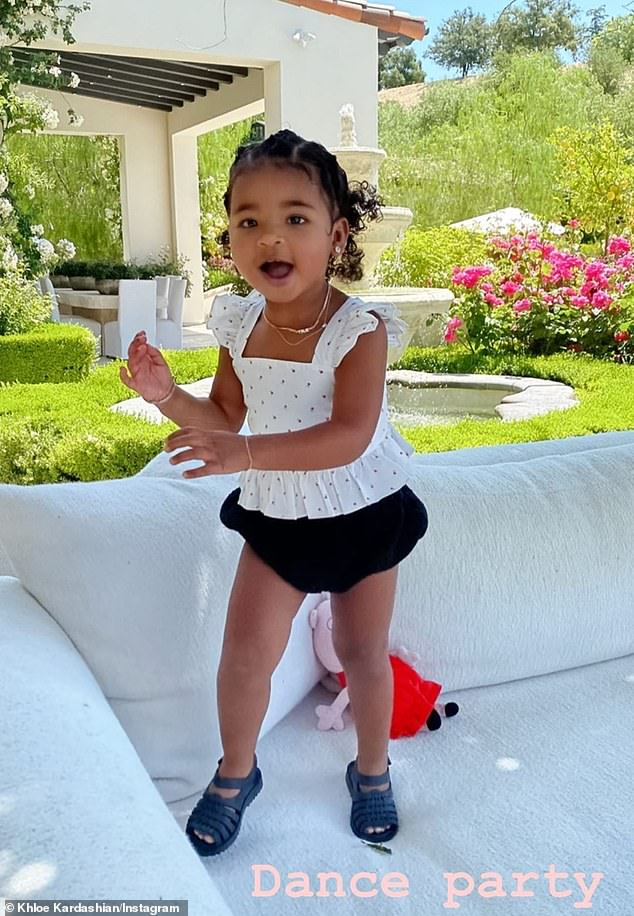 Having a blast: Khloé Kardashian, 35, shared some adorable photos of her daughter True, two, having a backyard 'Dance party' on Friday