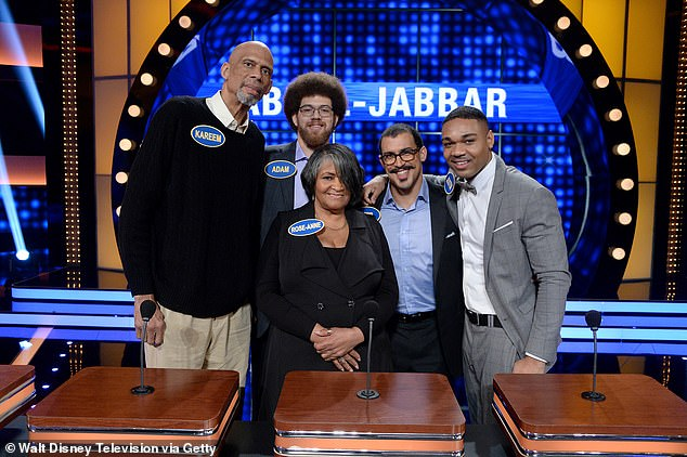 Adam Abdul-Jabbar (near left, alongside his father Kareem) photographed during a recording of Family Feud in 2017. Abdul-Jabbar allegedly stabbed Winsor after the two argued over trash cans because Winsor felt Abdul-Jabbar wasn't doing enough to help the 83-year-old woman he lives with