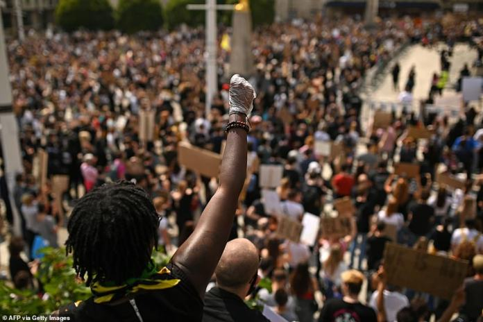 A protester makes a Black Lives Matter fist during a rally in support of the Black Lives Matter and Black Voices Matter movements in Leeds
