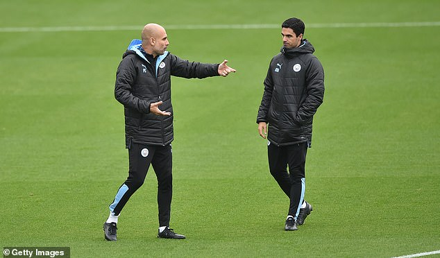 Guardiola (left) remains very close with Arteta (right) and remains in contact via WhatsApp