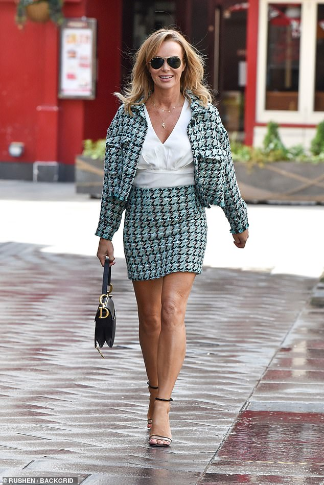 A vision: The Britain's got Talent judge, 49 years old, has been flaunting her eye-popping legs in all their glory in a small mini-skirt with a matching jacket as she paired the two pieces with a stylish white shirt and sky-high heels