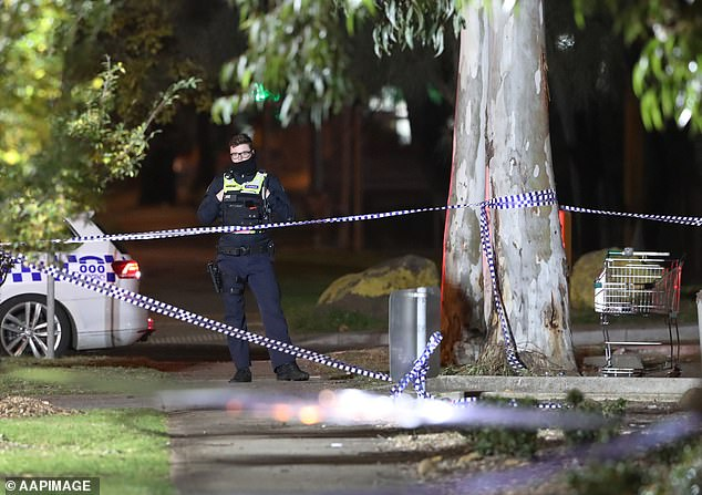 A police officer stands guard at the crime scene outside Brimbank Shopping Centre in Melbourne's outer western suburbs