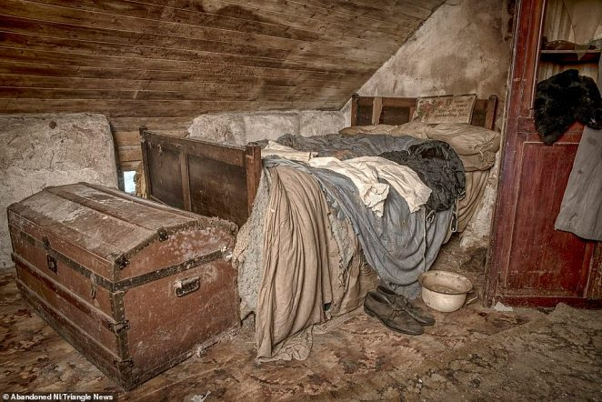 Bedroom: dirty bedsheets remained on the bed, while a chest and the owner's shoes lay abandoned next to the bedframe