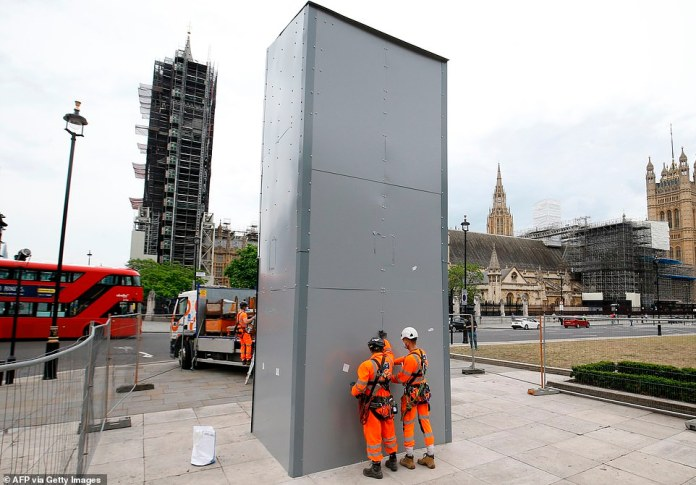 Workers arrived on Parliament Square in London today to remove the metal box surrounding the statue of former Prime Minister Sir Winston Churchill