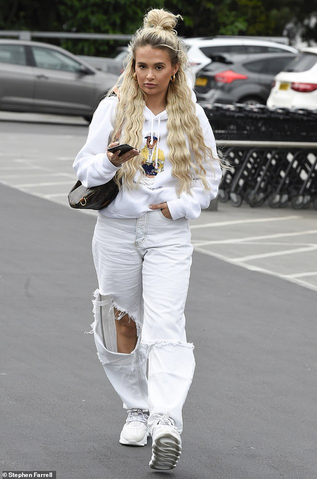 Casual:The Love Island star, 21, who has been grieving the loss of Mr Chai, cut a low-key figure in a white tracksuit