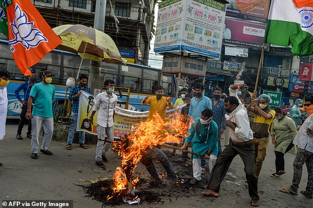 Bharatiya Janata Party (BJP) activists shout slogans as they burn posters and an effigy of Chinese President Xi Jinping during an anti-China demonstration in Siliguri on Wednesday