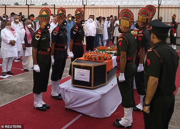 Indian army soldiers stand around the coffin of their colleague, who was killed in a border clash with Chinese troops in Ladakh