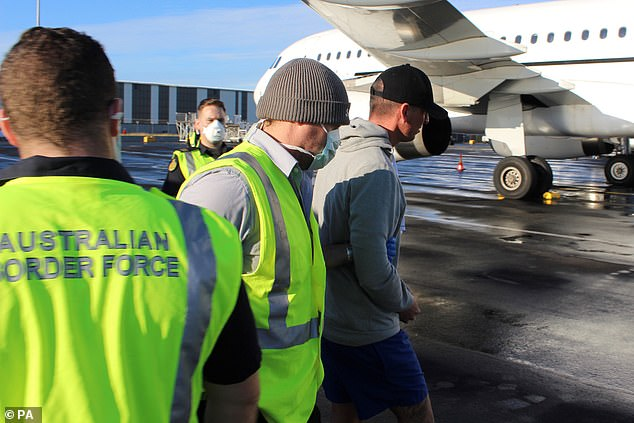 Jones is placed on an Australian Border Bureau officials plane Monday to be deported