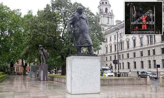 Workers arrive to remove metal box protecting statue of Sir Winston