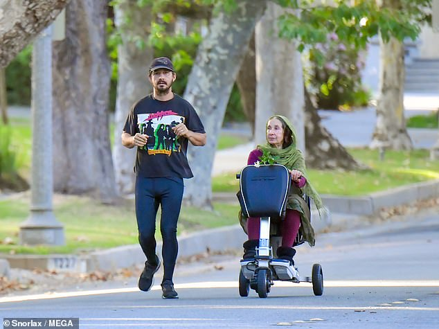 Outside: The actor, 34, appeared to be in a good mood as he strolled with his mother near her home in Los Angeles