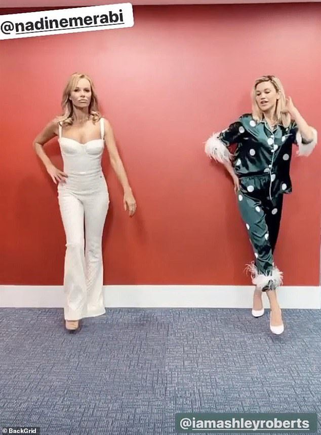 Company Two: Once inside, she laid a socially distant snap with Ashley Roberts, who wore incredible satin pajamas together