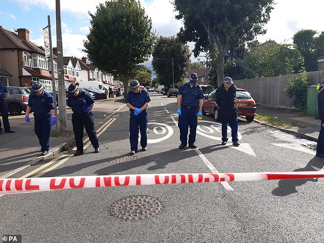 The lines of officers swept through a residential street in the North of Cheam, on Friday, for evidence after a father was shot and killed