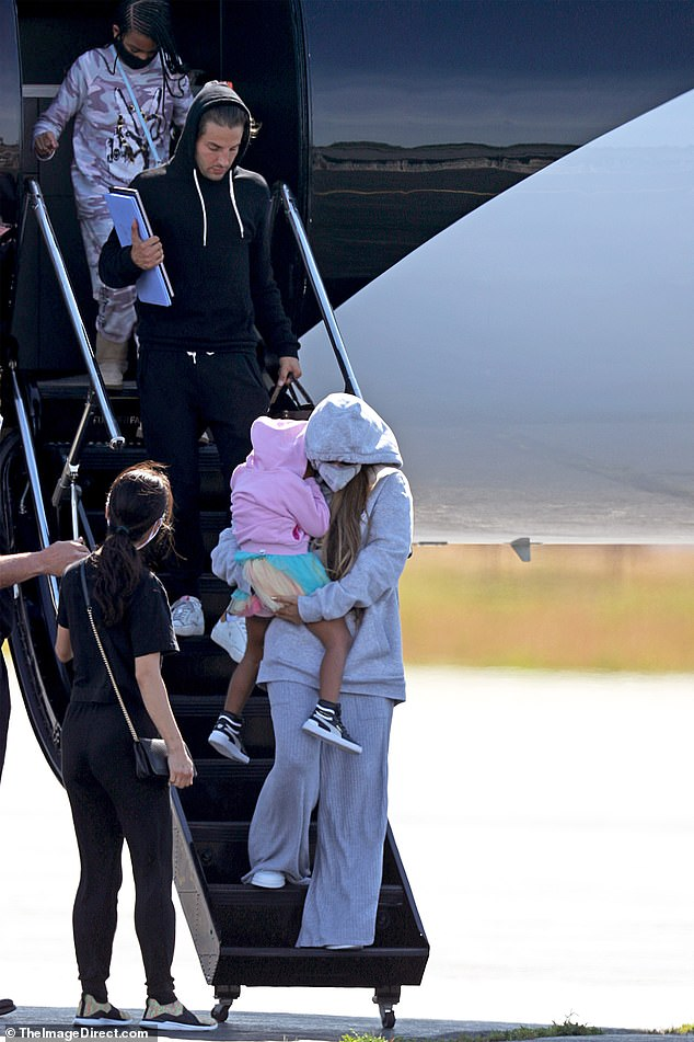 Family trip: Beyoncé, 38, and Jay-Z, 50, touched down in New York's East Hampton on Friday for a family getaway with Blue Ivy, eight, and their twins Rumi and Sir, three