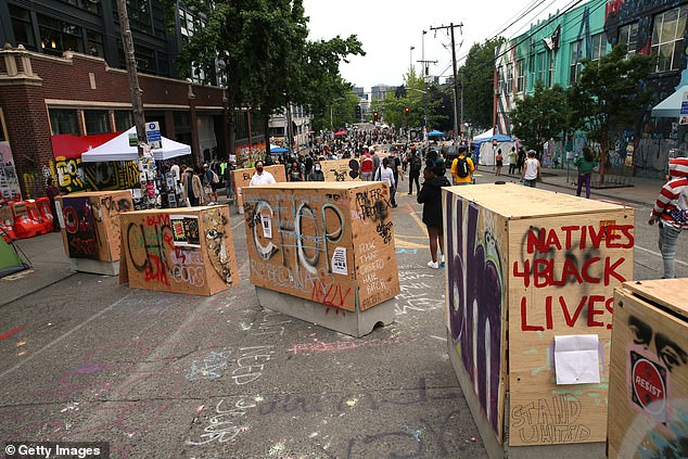 Barricades erected by the city several days ago divide up the CHOP zone on Friday