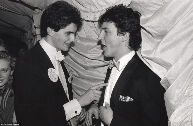 Getting to the point: David Cameron, who 'carried himself with the bearing of a cavalry officer', in animated conversation with a friend at the Oxford Union Valentine Ball in 1987