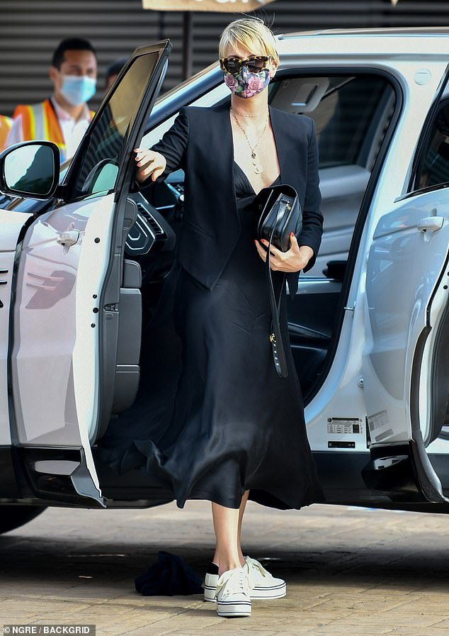 Valet:Charlize drove up to the popular restaurant in her white SUV and handed her keys over to the valet