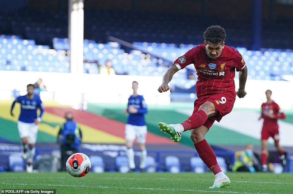 Roberto Firmino goes for goal for Liverpool during his side's clash against Everton at Goodison Park on Sunday evening