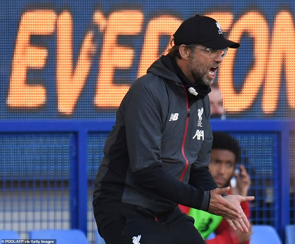 Liverpool manager Klopp gives his side instructions from the touchline during the game away to Everton on Sunday night