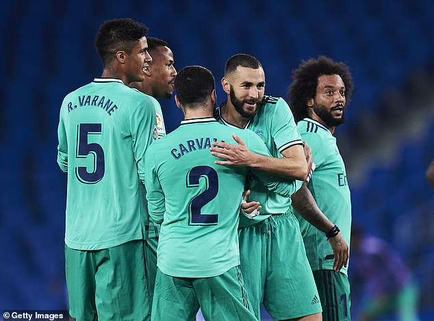 Karim Benzema (second right) scored Real Madrid's second to secure their win at Sociedad