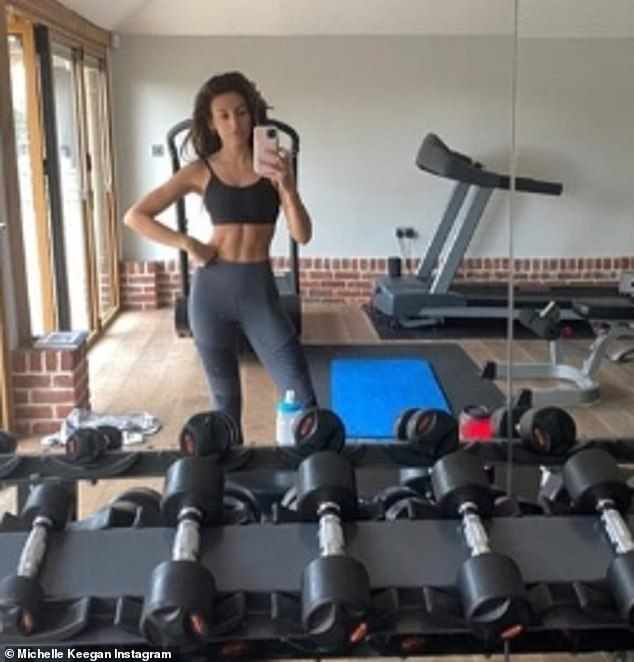 Wow: Michelle Keegan has shown the benefits of being in solitary confinement with Mark Wright, wowing in a gym selfie, Sunday, she revealed that she has been following his training regime