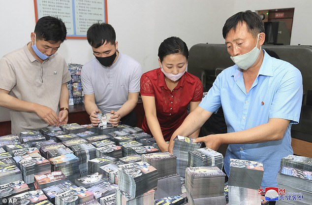 A photo provided by the North Korean government shows officials preparing anti-South Korea propaganda leaflets this week