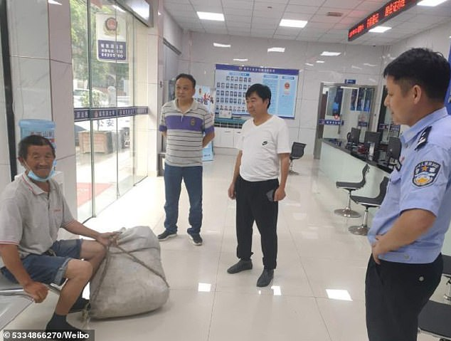 The news quickly became a trending topic on Chinese social media after tens of millions of Chinese web users were saddened by the elderly man¿s journey and pledged to help him find his family. The man is pictured being picked up by his family at a local police station in Zhejiang
