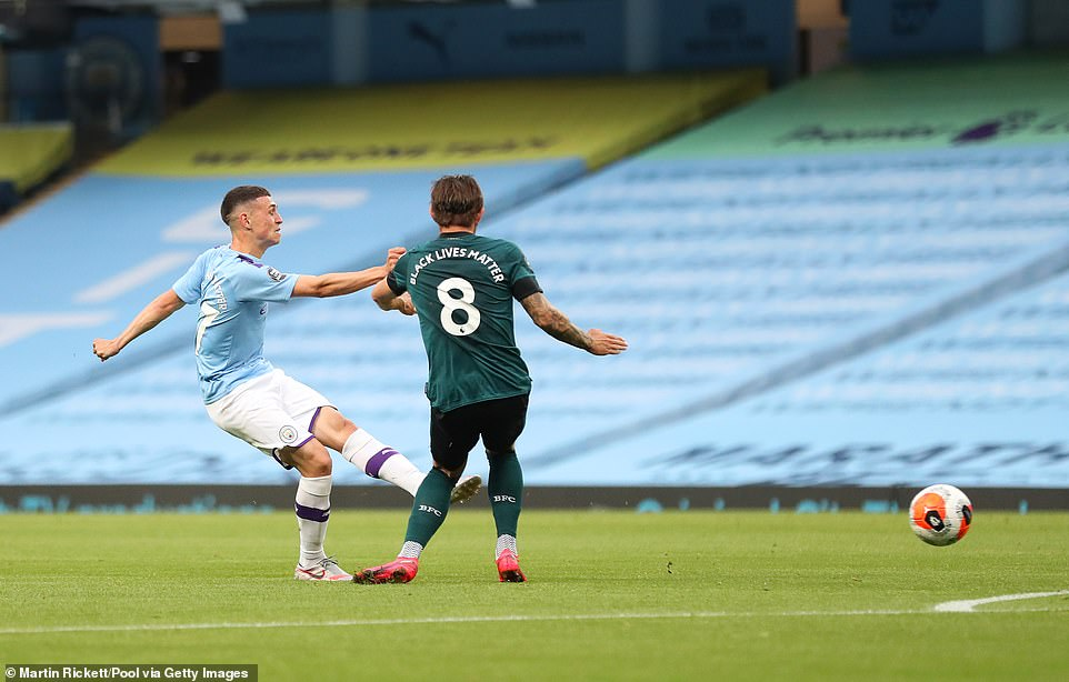 Foden hitting the ball from the edge of the box to score the opening goal despite being closed down by Josh Brownhill