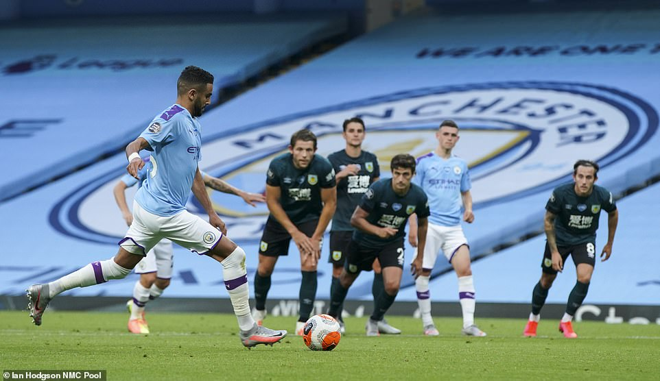 The Algerian scores City's third of the first-half from the spot after striker Sergio Aguero was felled in the penalty area